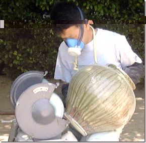 Kiln worker sanding off grit