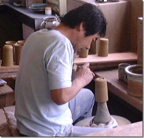 Kiln worker forming a foot